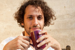 Boy drinking a cup of tea Stock Images