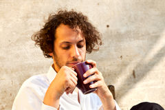 Boy drinking a cup of tea Royalty Free Stock Images