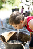 Boy drinking from fountain Stock Image