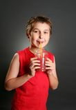 Boy drinking fresh berry juice Royalty Free Stock Images