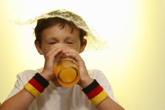Boy is drinking Royalty Free Stock Images