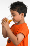 Boy drinking a glass of juice Stock Photos