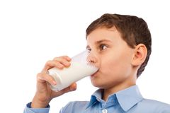 Boy drinking a glass of milk Royalty Free Stock Images