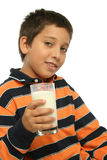 Boy drinking a glass of milk Stock Photography