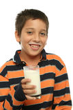 Boy drinking a glass of milk Royalty Free Stock Image
