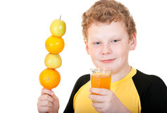 Boy drinking a glass of orange juice. On a white background Stock Photo