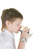 Boy drinking a glass of soda Stock Photos