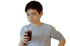 Boy drinking a glass of soft drink Stock Photography