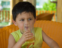 Boy drinking healthy juice Stock Image