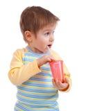 Boy drinking juice Royalty Free Stock Image