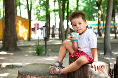 Boy drinking juice Royalty Free Stock Images