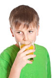 Boy drinking juice Royalty Free Stock Image