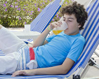 The  Boy is drinking juice Royalty Free Stock Images