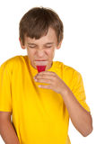 Boy drinking medicine Stock Photo