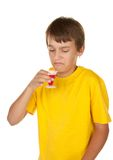 Boy drinking medicine Stock Photography