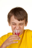 Boy drinking medicine on white Royalty Free Stock Photo
