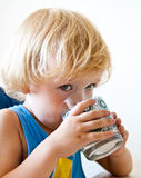 Boy drinking milk Stock Photos