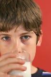 Boy drinking milk. A boy drinking a glass of milk Royalty Free Stock Photos