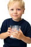 Boy drinking milk. Boy with glass of milk posing with his white mustache Stock Image