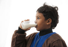 Boy Drinking Milk. Healthy Boy Drinking Milk Isolated on White Background stock images