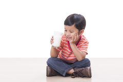 Boy drinking milk Royalty Free Stock Images