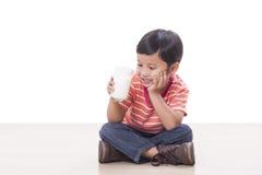 Boy drinking milk. Cute boy drinking milk on white Royalty Free Stock Images