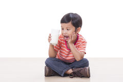 Boy drinking milk Royalty Free Stock Photography