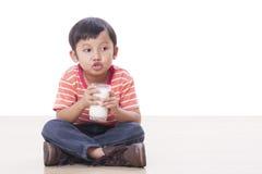 Boy drinking milk. Cute boy drinking milk on white Stock Photo
