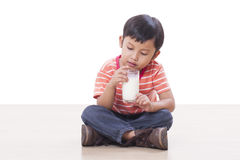Boy drinking milk Stock Images