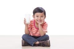 Boy drinking milk Stock Image