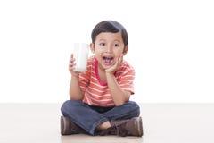 Boy drinking milk Royalty Free Stock Photo