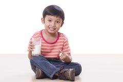 Boy drinking milk Royalty Free Stock Photos