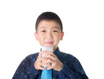 Boy drinking milk with milk mustache holding glass of milk isolated on white background Stock Images