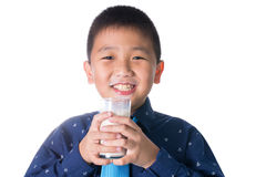 Boy  drinking milk with milk mustache holding glass of milk isolated on white background Stock Photo