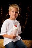 Boy drinking milk shake Stock Images