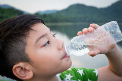 Boy drinking mineral water Stock Photo