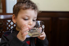 Boy drinking mint tea Stock Photography