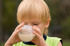 Boy drinking on  nature milk Royalty Free Stock Photo
