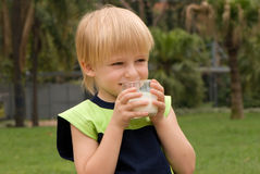 Boy drinking on  nature milk Royalty Free Stock Image