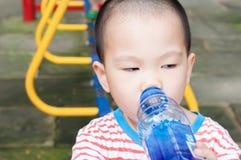 Boy drinking Stock Image