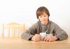 Boy drinking tea Royalty Free Stock Images