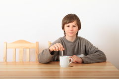 Boy drinking tea Royalty Free Stock Photography
