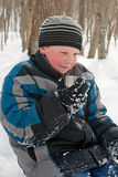 Boy drinking warming drink. In the winter Stock Photos