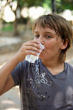 Boy drinking water . Boy drinking water from disposable cups royalty free stock images