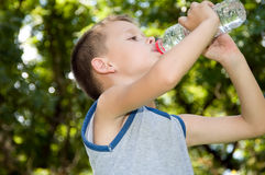 Boy drinking water Stock Photos
