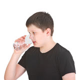 Boy drinking water Royalty Free Stock Photos