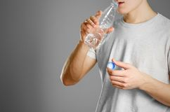 Boy drinking water from clear plastic bottles Royalty Free Stock Images