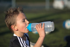 Boy drinking water Royalty Free Stock Images