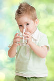 Boy drinking water from glass Royalty Free Stock Images
