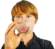 Boy drinking water out of a glass Stock Photo